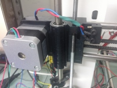 old left X axis carriage. accidentally widened the holed on the wrong side so I had to mount the motor backwards